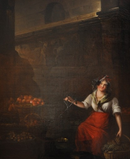 Marchande de fruits pesant du raisin